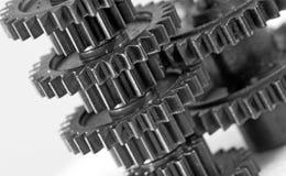 Image de plan rapproché de roue dentée travail d'équipe d'isolement par illustration noire du concept 3d Photographie stock libre de droits