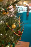 Image of decorated Christmas tree with balls and beads. Close-up Stock Photo
