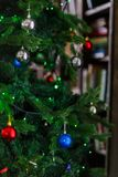 Image of decorated Christmas tree with balls and beads. Close-up Stock Image