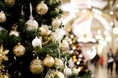 Image of decorated Christmas tree with balls and beads. Close-up Royalty Free Stock Photo