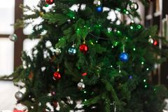 Image of decorated Christmas tree with balls and beads. Close-up Stock Photos