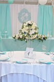 Image of a decorated wedding guest table. Image of a beautifully decorated with cloth, flowers and accessory wedding guest table Royalty Free Stock Photography