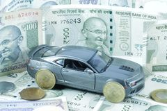Car Loan, Car Insurance, Car Expenses. An image depicting car loan or car insurance cover or Car related expenses. Car with coins. Car with Money. Car Repair stock image