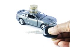 Car Loan, Car Insurance, Car Expenses, Car Hire. An image depicting car loan or car insurance cover or Car related expenses. Car with coins. Car with Money. Car royalty free stock image