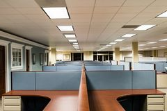 Empty Office Space Ready to Occupy. This image depicts an empty office ready for occupation by a workforce or company.  It is a typical cubicle environment with Royalty Free Stock Photo