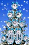 Image des réveils sur un arbre de Noël photos libres de droits