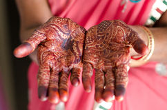 Image detail of henna being applied to hand. Royalty Free Stock Photo