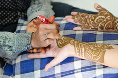Image detail of henna being applied to hand. Royalty Free Stock Photos
