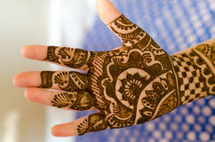 Image detail of henna being applied to hand. Stock Photo