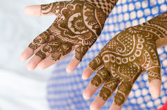 Image detail of henna being applied to hand. Beautiful Royalty Free Stock Images