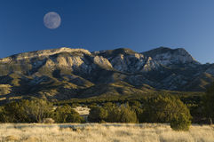 Image details. Full moon rises over the Sandia Mountain Range near Albuquerque, New Mexico stock image