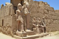 Elements and details of the interior of the Karnak temple in Luxor. The image of the details inside of the Karnak temple. Ancient carved walls and statues of royalty free stock photography