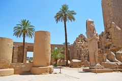 Elements and details of the interior of the Karnak temple in Luxor. The image of the details inside of the Karnak temple. Huge ancient walls, columns, statues stock image