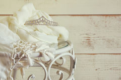 Image of diamond tiara on vintage table. vintage filtered. selective focus.  Stock Photo