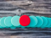 Image of different colored plastic caps on wooden background stock photography