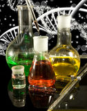 Image of different glassware and dna chain on a black background Stock Images