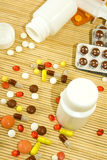 Image of different pills on a table closeup Stock Image