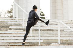 Image of disabled running girl in sportswear, training and stretching prosthetic leg in stadium outside royalty free stock images