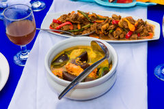 The image of the dishes and food on the served table Stock Image