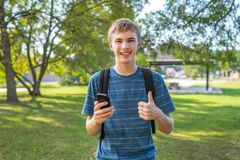 Teenager on his cellphone. royalty free stock images