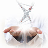 Image of dna strand. Against background with human hands royalty free stock photography