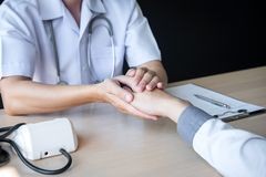 Image of doctor holding patient`s hand to encourage, talking with patient cheering and support stock images