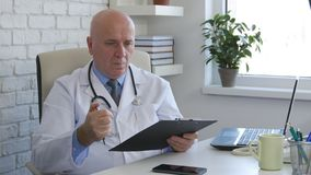 Doctor in Hospital Office Start Writing a Medical Recipe stock photos