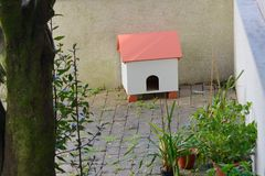 Doghouse on the terrace of the house. Image of doghouse on the terrace of the house royalty free stock image