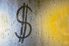 An image of a dollar on a misted window. Concept: finance, destabilization royalty free stock photos