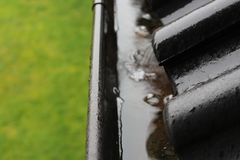 An image of a drain with raindrops. Roof - abstract Stock Image