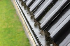 An image of a drain with raindrops. Roof - abstract Royalty Free Stock Images