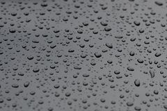 Drops of water on a metal surface closeup. Image of drops of water on a metal surface closeup royalty free stock photos