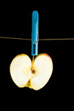 Image of drying apple on a rope on a black background Royalty Free Stock Photos