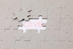 Image du morceau de puzzle avec amour Photographie stock libre de droits