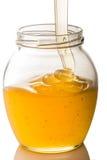 Image du pot de miel d'isolement sur le fond blanc photos libres de droits