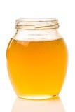 Image du pot de miel d'isolement sur le fond blanc images libres de droits