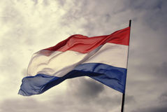 Dutch Flag. Image of the dutch flag fluttering in the wind on a cloudy day Stock Images