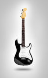 Image of electric guitar over gray background Stock Images