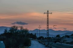 Image of electricity towers at sunset royalty free stock images