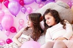 Image of elegant girlfriends posing in playroom Stock Image