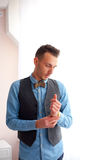 Image of elegant man standing by window Royalty Free Stock Images