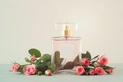 Image of elegant perfume bottle. back light photo. vintage filtered image. stock photos