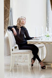 Image of elegant slim woman waits waiter Royalty Free Stock Photo