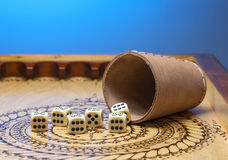 Image of elements of gambling on a carved wooden board figures six, blue Stock Photos