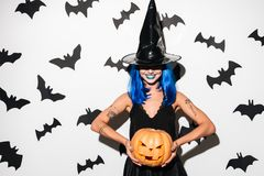 Emotional amazing young woman in witch halloween costume Royalty Free Stock Photo