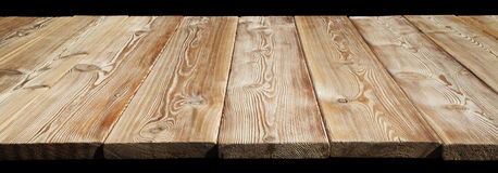 Image of empty wooden table top  on black Stock Photo