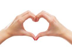 Image en gros plan des mains femelles dans une forme d'un coeur Photo stock