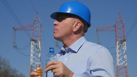 Engineer Electrician Work Eat a Sandwich and Drink Water stock image