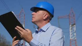 Engineer Image Working with a Clipboard in Hand. Image with Engineer Working with a Clipboard in Hand royalty free stock photos