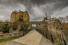 Image of the entrance of the castle Franchimont in ruins with its tower and a wooden treadwheel crane royalty free stock photo